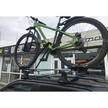 Крепление для велосипедов на крышу автомобиля.